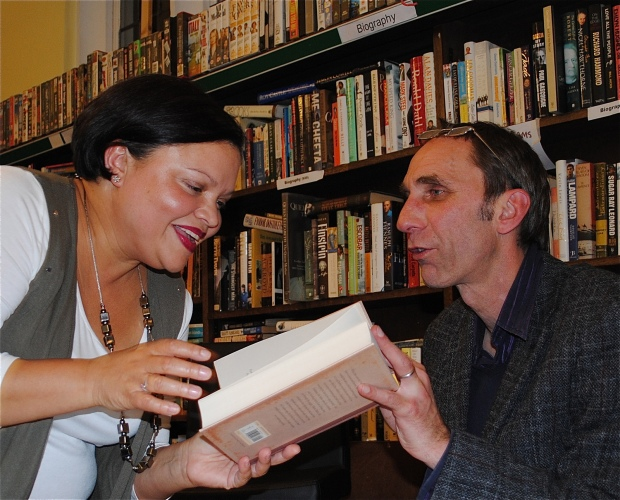 Supporter Will self signs a copy of his book at Friern Barnet Library